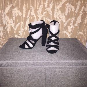 Black suede sandals.